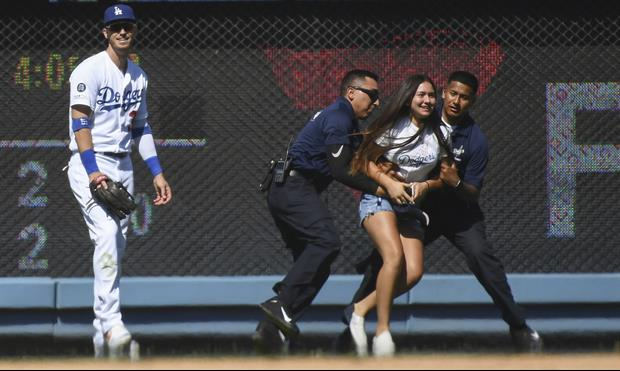 Watch 14-Year-Old Girl Run Onto Field To Hug Dodgers' Cody Bellinger