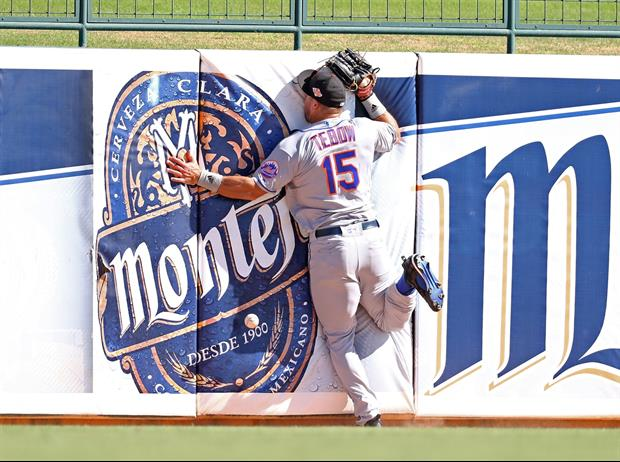 Tim Tebow Face Plants Into Wall Going For Fly Ball