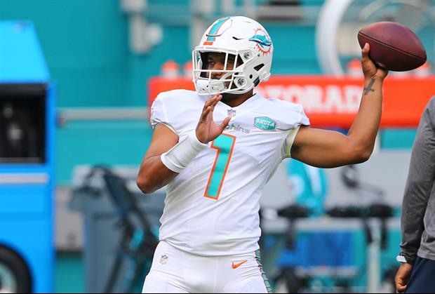 Here's Tua Tagovailoa Sitting On The Field Alone On The Phone After Today's Dolphins GameHere's Tua